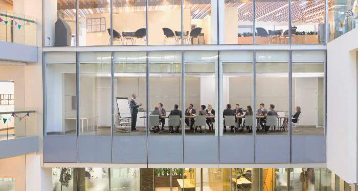 View of business people meeting in conference room of modern building